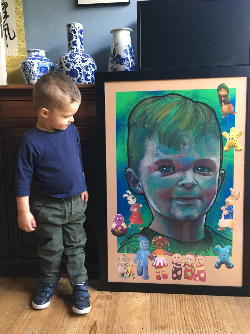 Grandson Teddy admiring his portrait